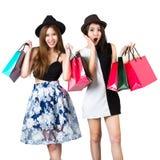 Belles filles de l'adolescence asiatiques portant des paniers Photos libres de droits