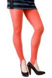 Belles longues pattes minces de femme photos stock