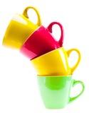 Belles tasses de couleur jaune, rouge, verte Photographie stock libre de droits