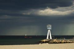 Thunderstorm is comming to Bellevue Beach north of Copenhagen, Denmark. Bellevue Beach near Copenhagen, with round barrel shaped life guard tower royalty free stock image