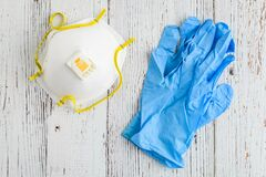 Free BELLEVUE, WA/USA – APRIL 30, 2020: PPE On A Rustic White Background, 3M N95 Mask And Blue Nitrile Gloves Royalty Free Stock Photos - 183346888
