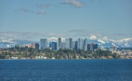 Bellevue, Washington and Cascade Mountains across Lake Washingto. The Snow Capped Cascade Mountain Range stand Tall Behind the City of Bellevue, Washington and Royalty Free Stock Photography