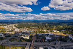 Bellevue Washington USA industrial area with mountain view in. Bellevue Washington USA industrial area with mountain view aerial drone image royalty free stock photography