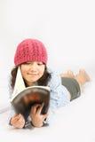 Belleza asiática con el sombrero rojo Foto de archivo libre de regalías