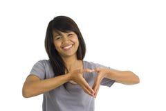 Belleza asiática que forma un corazón Fotografía de archivo libre de regalías