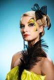 Belleza con cara-arte de la mariposa Fotografía de archivo libre de regalías