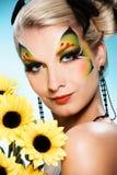 Belleza con cara-arte de la mariposa Fotos de archivo libres de regalías