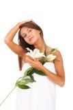 Belleza con el lirio blanco Foto de archivo