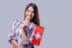 Belleza con la bandera suiza Imagenes de archivo