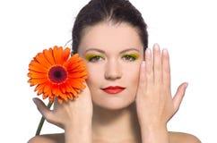 Belleza con la flor Foto de archivo libre de regalías