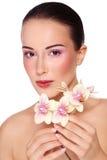 Belleza con la orquídea fotografía de archivo