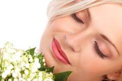 Belleza con las flores Fotografía de archivo
