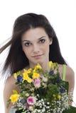 Belleza con un manojo de flores Imágenes de archivo libres de regalías