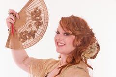 Belleza con un ventilador Foto de archivo libre de regalías
