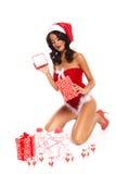 Belleza de la Navidad en el fondo blanco - piernas largas atractivas imagen de archivo libre de regalías