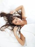 Belleza en cama Foto de archivo