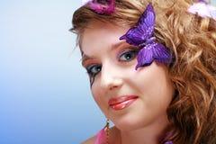 Belleza joven con cara-arte de la mariposa Fotos de archivo libres de regalías