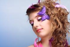 Belleza joven con cara-arte de la mariposa Fotografía de archivo libre de regalías