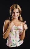 Belleza joven que muestra el pulgar encima de la muestra Imágenes de archivo libres de regalías