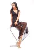 Belleza Leggy en una alta silla Fotos de archivo libres de regalías