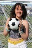 Belleza morena con el balón de fútbol Imágenes de archivo libres de regalías