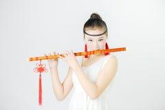 Bellezza della Cina nel salto della flauto Fotografie Stock Libere da Diritti