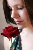 Bellezza e una rosa Immagini Stock