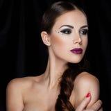 Bellezza sul nero Fotografia Stock