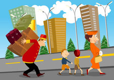 Bellhop carrying luggage. Bellhop helping a woman with children to carry luggage on his back Royalty Free Stock Photo
