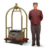 Bellhop with Luggage Cart. Bellhop in retro uniform and luggage cart on a white background with clipping path on bellman Royalty Free Stock Image