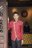Bellhop smiling at Hotel Entrance, portrait Royalty Free Stock Photo