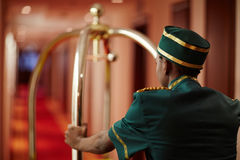 Bellhop Working in Hotel Carrying Bags Royalty Free Stock Image