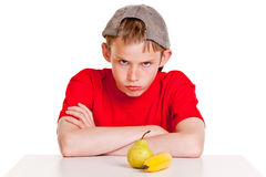 Belligerent young boy with fruit Stock Photography