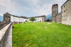 Castelgrande castle in Bellinzona, Switzerland. Bellinzona, Switzerland - May 28, 2016: Tourists in the courtyard of the Castelgrande castle at Bellinzona on the Royalty Free Stock Photo