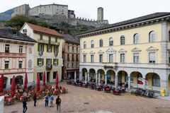 Bellinzona, Switzerland - 15 October 2014: People walking and si Stock Image