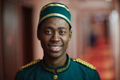 Bellman. Happy young hotel porter in uniform looking at camera Stock Photography