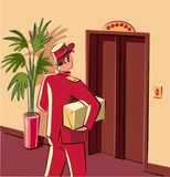 Bellman in red livery, which is preparing to enter an elevator,. To personally deliver a parcel Stock Photo