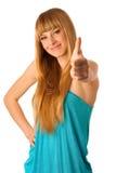 Bello adolescente biondo che mostra pollice su come segno di allr Immagine Stock Libera da Diritti