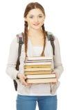 Bello adolescente con lo zaino ed i libri Fotografia Stock
