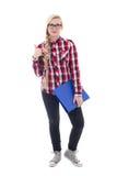 Bello adolescente in occhiali con il libro in suo pollice della mano Fotografia Stock Libera da Diritti