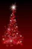 Bello albero di Natale rosso del bokeh Fotografie Stock Libere da Diritti