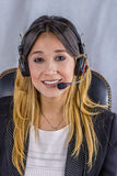 Bello consulente della call center in cuffie Fotografie Stock