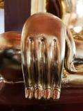 Bello dettaglio della mano di Buddha dell'oro fotografie stock libere da diritti