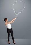 Bello disegno del pallone della tenuta della donna Immagine Stock Libera da Diritti