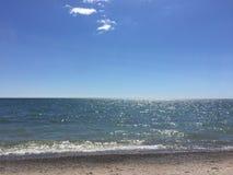 Bello e giorno soleggiato alla spiaggia Fotografia Stock