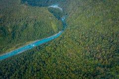 Bello fiume del turchese e del paesaggio, nelle alpi del sud del sud del ` s di Westland, la Nuova Zelanda Fotografia Stock