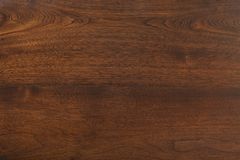 Bello fondo di struttura di legno della noce fotografia stock
