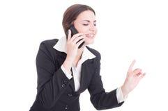 Bello giovane direttore aziendale femminile che parla sul telefono Immagine Stock