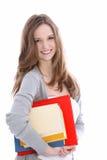 Bello giovane studente sorridente con i libri Immagine Stock Libera da Diritti