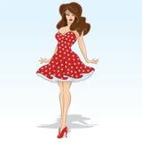 Bello modello del brunette in un vestito rosso dal puntino di Polka Fotografia Stock